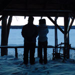 Grant (Gordon Pinsent) and Fiona (Julie Christie) silhouetted looking out on the frozen lake in Away From Her